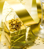 Golden gift box with ribbon — Stok fotoğraf