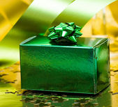 Green gift box with ribbon — Stock Photo