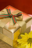 Gift box with yellow flower — Stock Photo