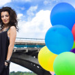 Happy woman with balloons — Stock Photo #1430233