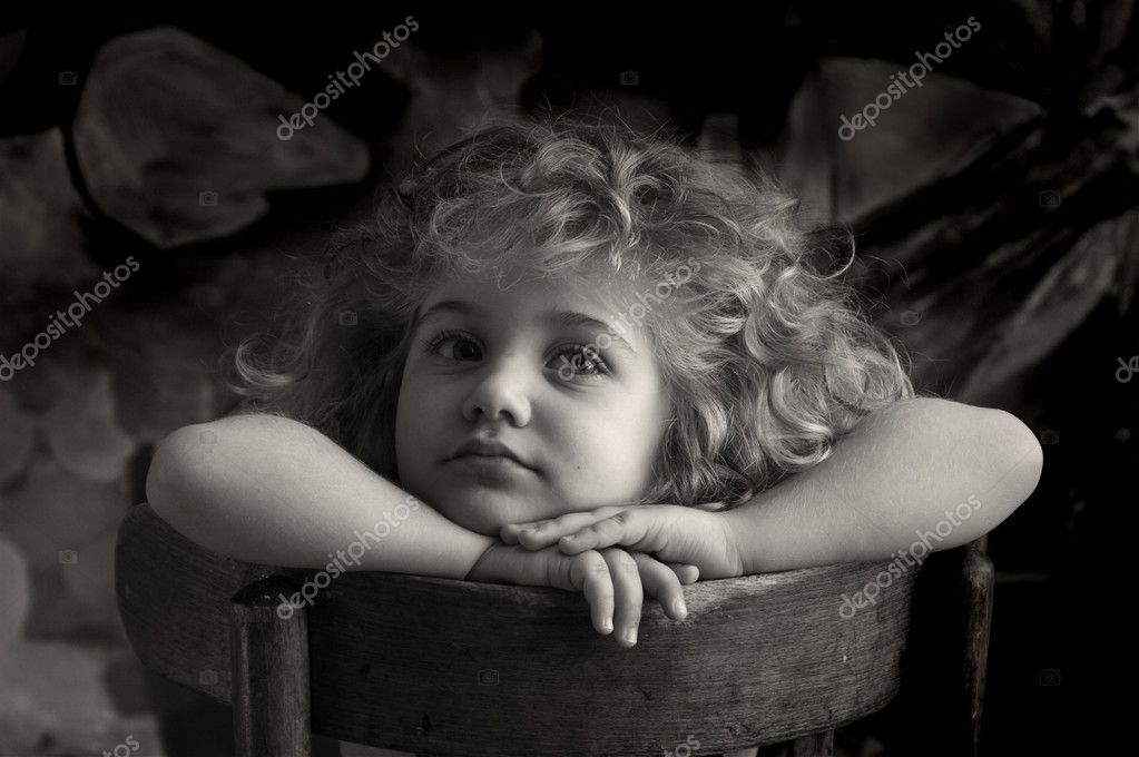 A little girl with a thoughtful eye  Stock Photo #1397026