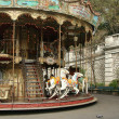 French old carousel with horses - Stock Photo