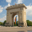 Triumphal Arch with flag - Stock Photo