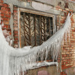 Big icicle and window — Stock Photo #1429304