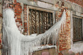 Big icicle and window — Stock Photo