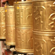 Golden prayer wheels — Stock Photo #1471818