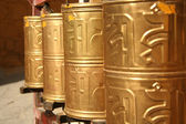 Golden prayer wheels — Stock Photo