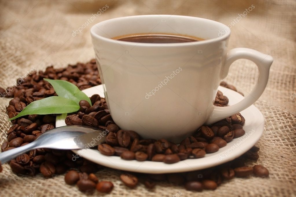 Cup of coffee on canvas background — Stock Photo #1409222