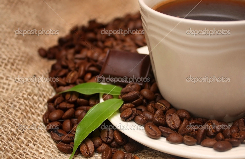 Coffee cup on canvas background — Stock Photo #1409245