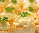 Small snacks with cheese salad — Stock Photo