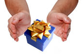 Gift in man hands — Stock Photo