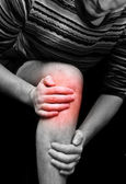 Young man having knee ache — Stock Photo