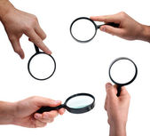 Set of human hands holding magnifier — Stock Photo