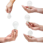 Set of energy bulbs in human hands — Stock Photo