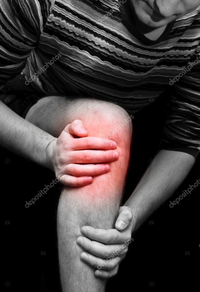 Young man having knee ache — Stock Photo #1436330