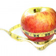 Apple with measure tape — Stock Photo