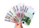 Isolated hand holding money — Stock Photo