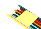 Multicolored pencils and note stick iso — Stock Photo