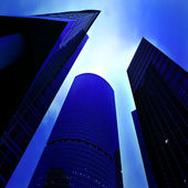 Underside view to business skyscrapers — Stock Photo