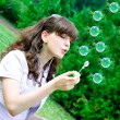Royalty-Free Stock Photo: Smile teen blowing soap bubbles