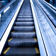 Escalator by motion in business hall - Stock Photo