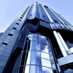 Illuminated modern building skyscraper — Stock Photo