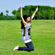 Smile teen open hands jumping — Stock Photo