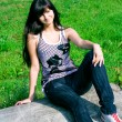 Smile teen sitting on the stone — Stockfoto