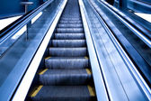 Escalator by motion in business hall — Stockfoto