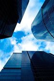 Business skyscrapers vanishing in clouds — Stock Photo