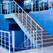 Marble staircase with a steel handrail - Stock Photo