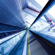Moving escalator in the office hall — Stock Photo #1431594