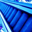 Blue footsteps of moving escalator — Stock Photo