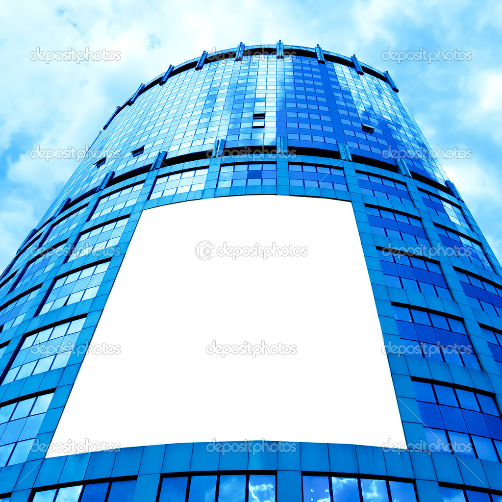 Modern skyscraper with white placard in the center  Stock Photo #1431783