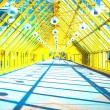 Glass Yellow corridor in office — Stock Photo #1455322