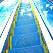 Moving escalator in the office hall — Stock Photo
