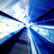 Moving escalator in the office hall — Stock Photo #1485968