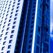 Blue abstract crop of modern office - Stock Photo
