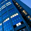 Fragment of illuminated business tower — Stock Photo