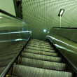 Green escalator, office interior - Stock Photo