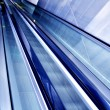 Stock Photo: Moving escalator in the office hall