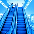Moving escalator with stairs - Stock Photo