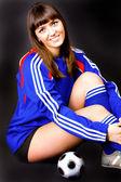 Pretty girl with soccer ball — 图库照片