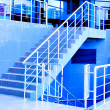 Foto Stock: Marble staircase with steel handrail