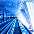 Moving escalator in business hall - Stock Photo