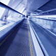 Royalty-Free Stock Photo: Fast moving escalator by motion