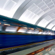 Moving train on underground station - Stock Photo