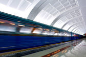 Moving train on underground station — Stockfoto