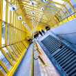 Stock Photo: Staircase and yellow glass corridor
