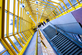 Staircase and yellow glass corridor — Stock Photo